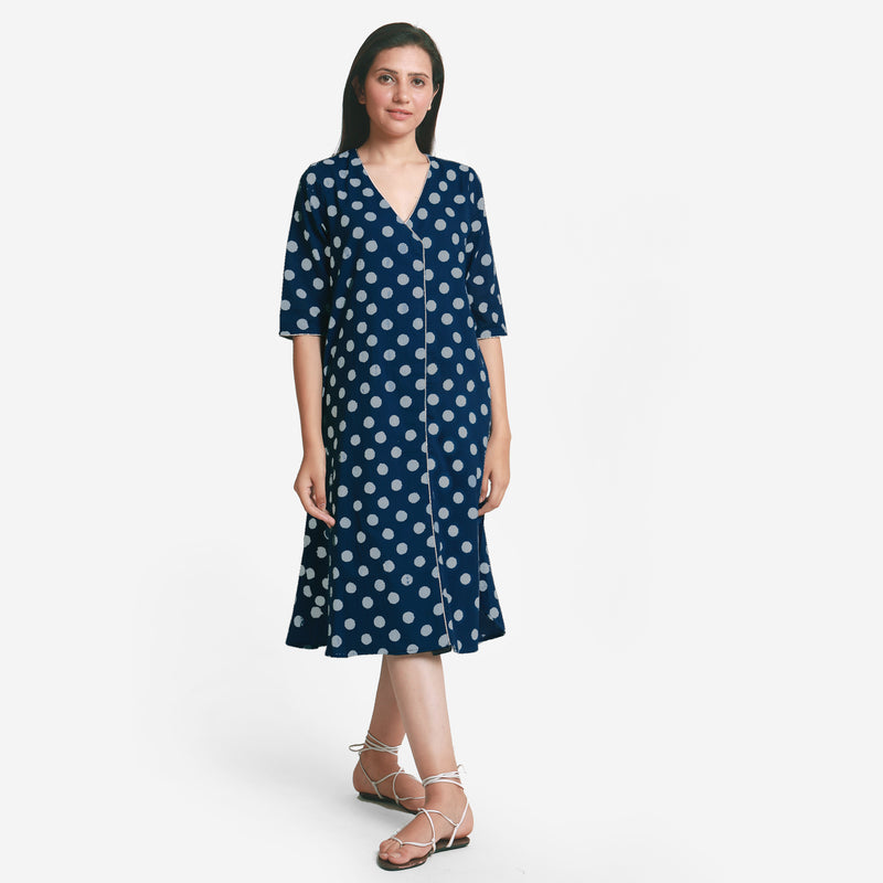 Front View of a Model wearing Indigo Polka Dot Plunge Neck Dress