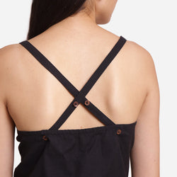 Back Detail of a Model wearing Solid Black Criss-Cross Tank Top