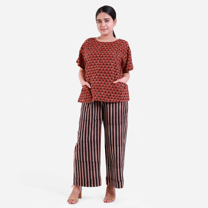 Front View of a Model wearing Block Printed Bagru Top and Striped Pant Set