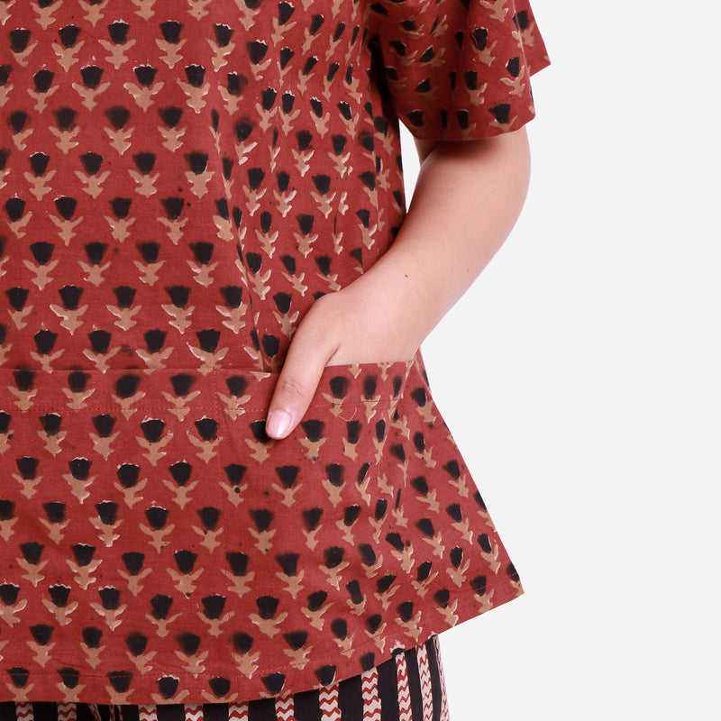 Front View of a Model wearing Brick Red Floral Block Print Straight Top