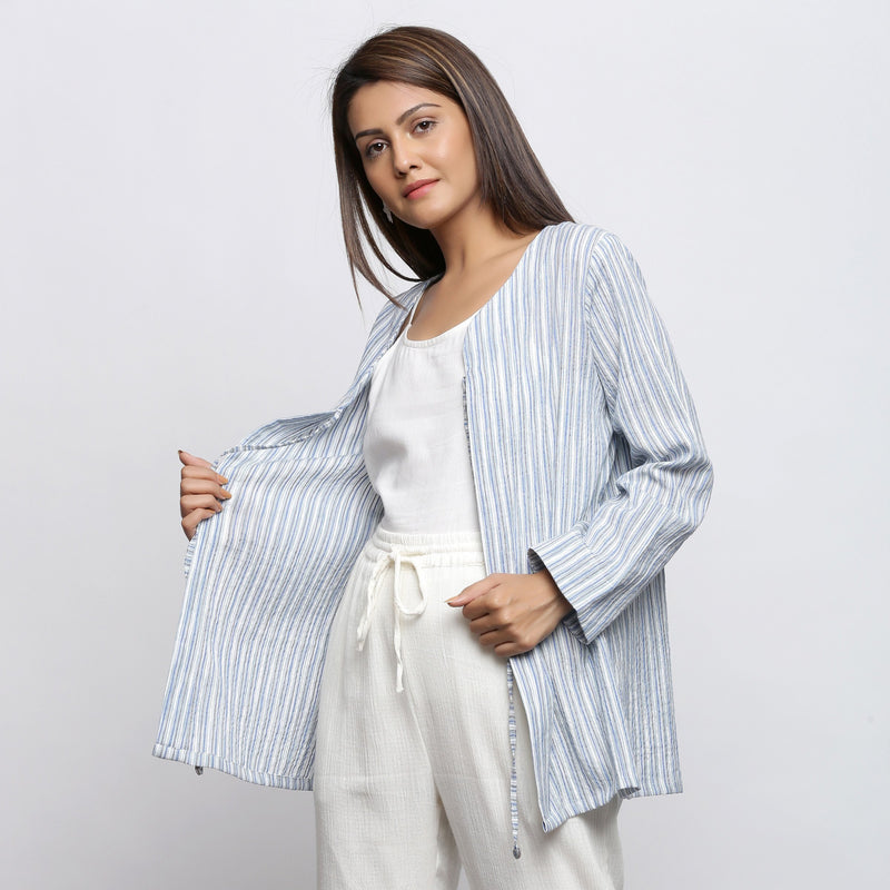 Left View of a Model wearing Blue and White Striped V-Neck Shrug