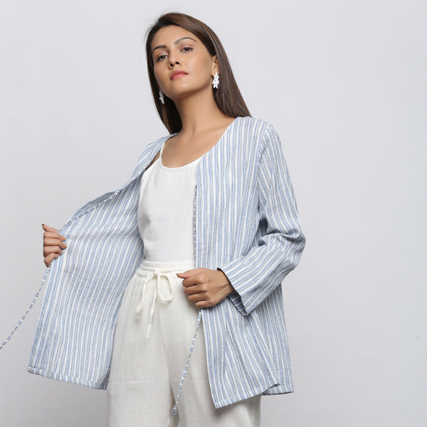 Front View of a Model wearing Blue and White Striped V-Neck Shrug