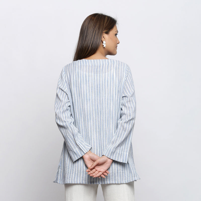 Back View of a Model wearing Blue and White Striped V-Neck Shrug