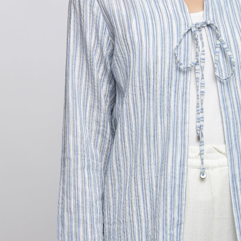Front Detail of a Model wearing Blue and White Striped V-Neck Shrug