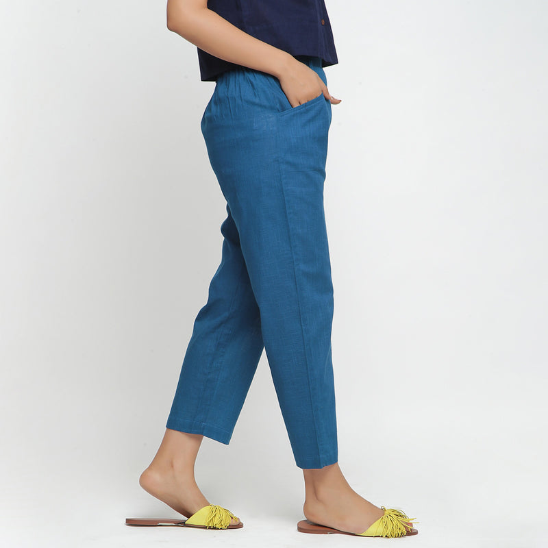 Right View of a Model wearing Teal Ankle Length Mid-Rise Chinos