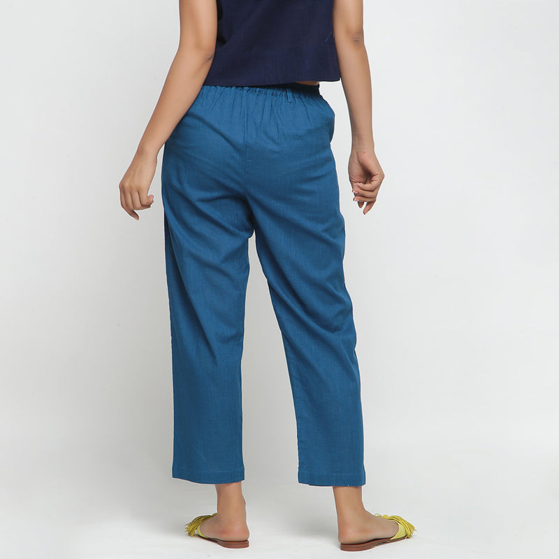 Back View of a Model wearing Teal Ankle Length Mid-Rise Chinos