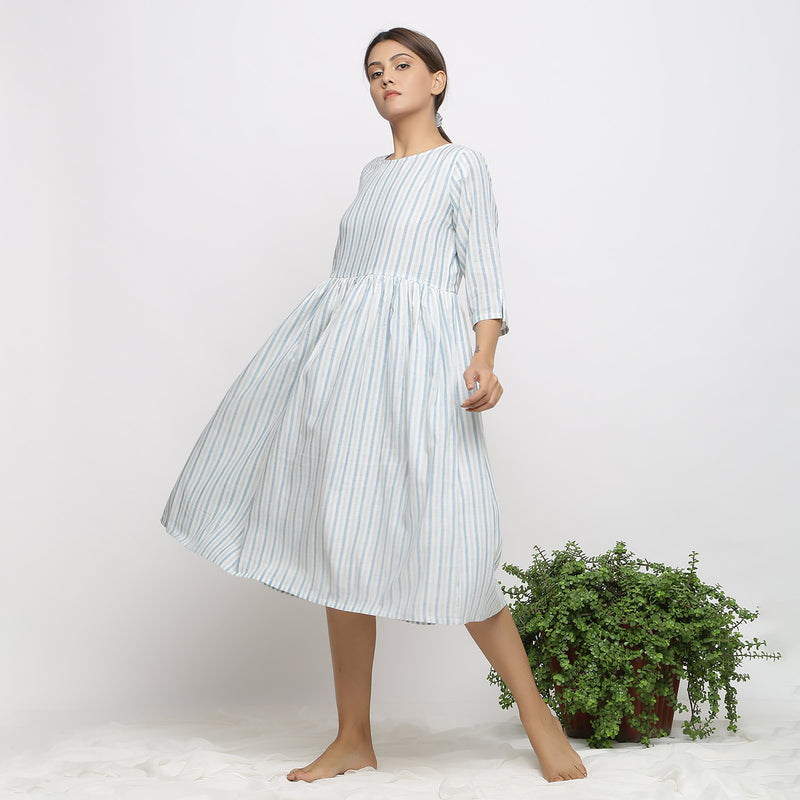 Left View of a Model wearing Airy Off-White Handspun Yoke Dress