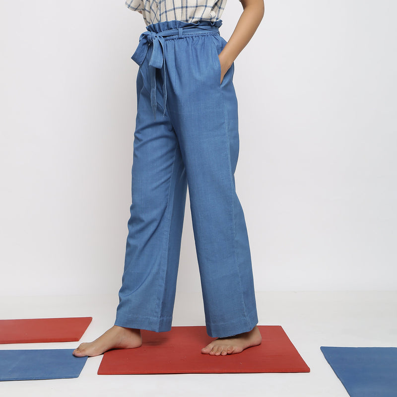 Left View of a Model wearing Vegetable Dyed Wide Legged Paperbag Pant