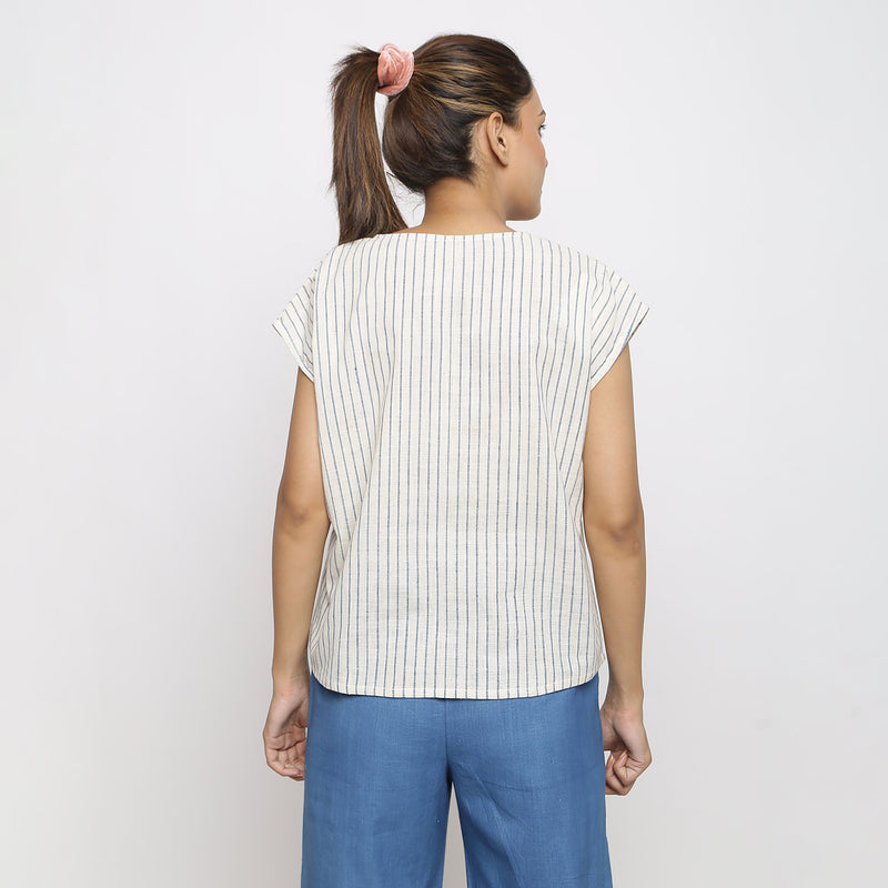 Back View of a Model wearing Vegetable Dyed Off-White Straight Top