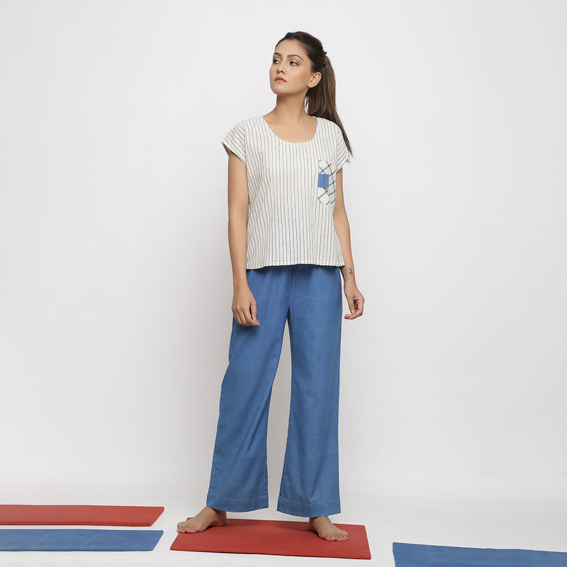 Front View of a Model wearing Airy Off-White Top and Paperbag Pant Set