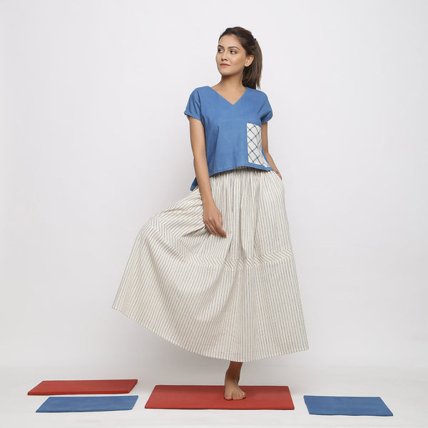 Front View of a Model wearing Airy Handspun Blue Top and Striped Skirt Set