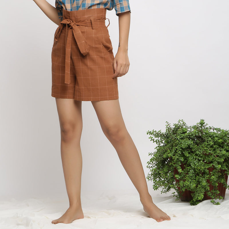 Left View of a Model wearing Almond Brown Handspun Paperbag Shorts