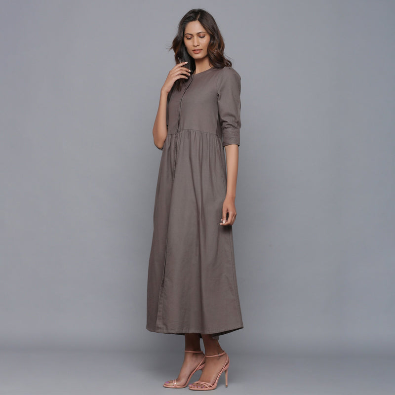 Left View of a Model wearing Ash Grey Flannel Gathered Dress