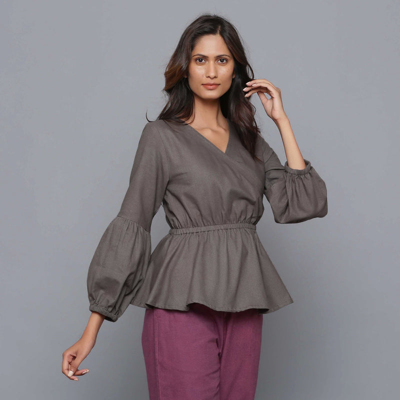 Right View of a Model wearing Ash Grey V-Neck Flannel Peplum Top