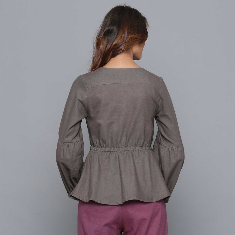 Back View of a Model wearing Ash Grey V-Neck Flannel Peplum Top