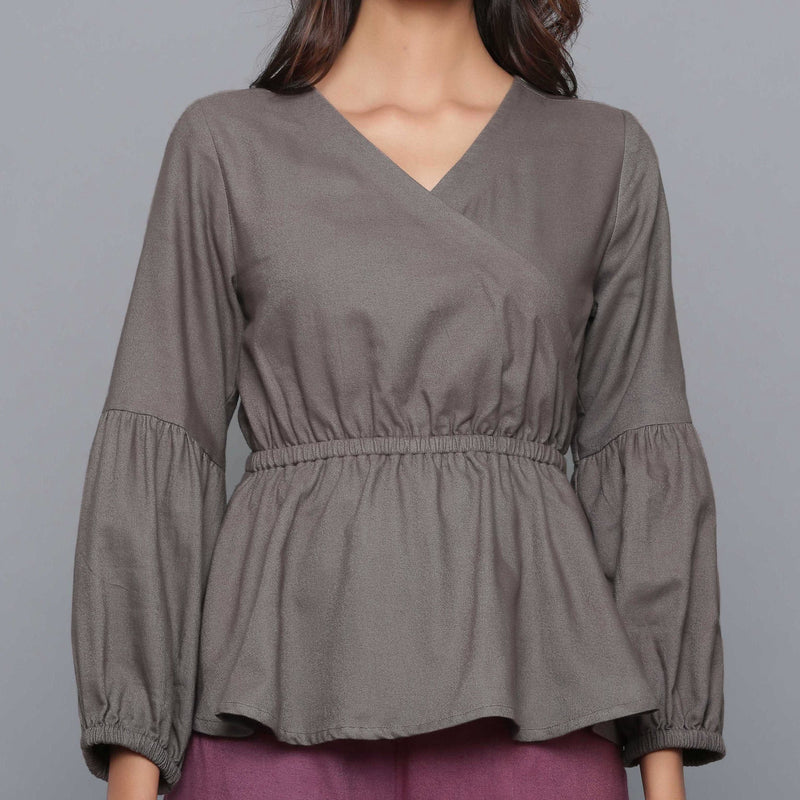 Front Detail of a Model wearing Ash Grey V-Neck Flannel Peplum Top