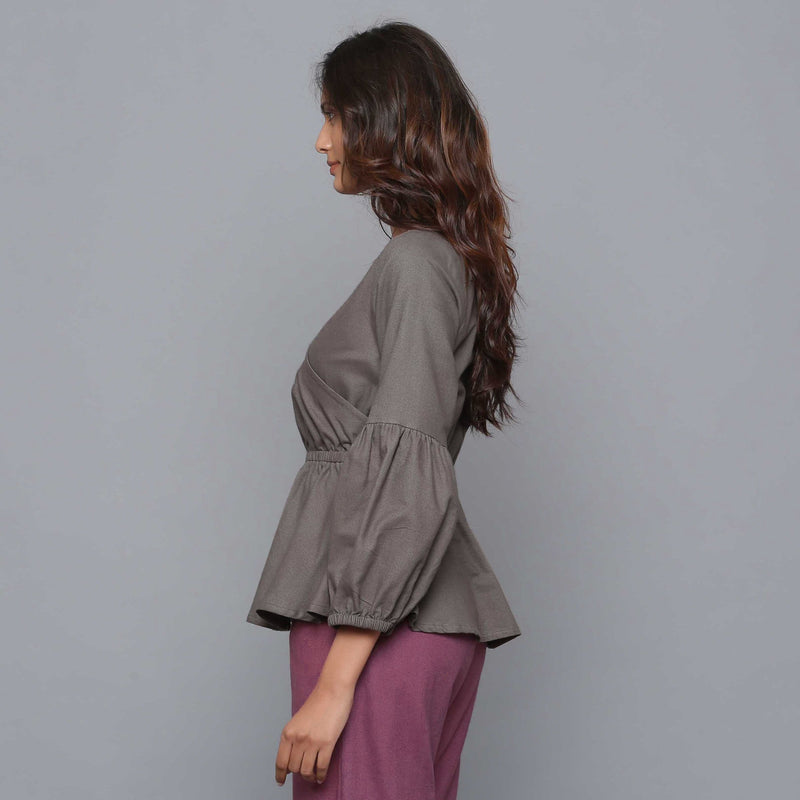 Left View of a Model wearing Ash Grey V-Neck Flannel Peplum Top