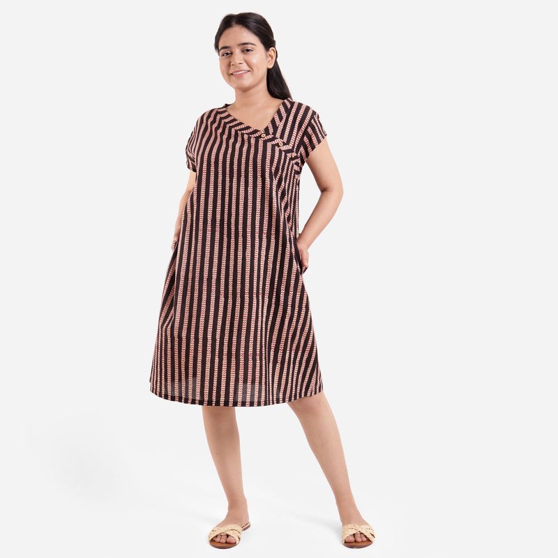 Front View of a Model wearing Asymmetric A-Line Striped Dress