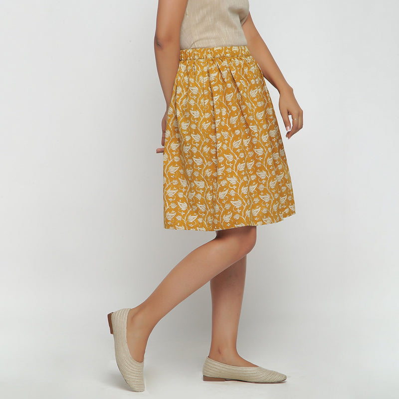 Right View of a Model wearing Bagru Print Mustard Mid Rise Skirt