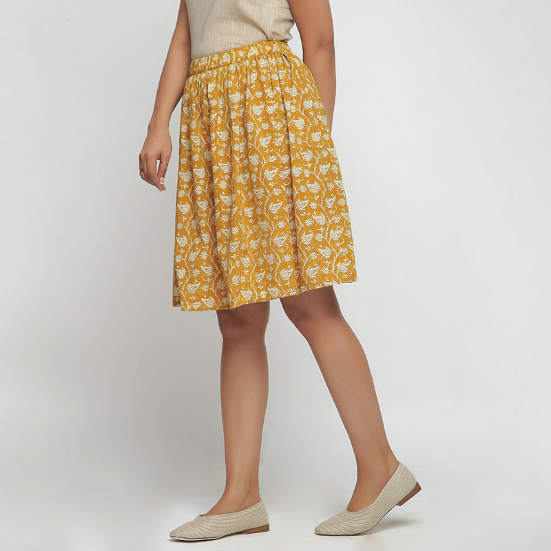 Left View of a Model wearing Bagru Print Mustard Mid Rise Skirt