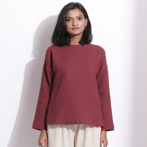 Front View of a Model wearing Barn Red Cotton Waffle Drop Shoulder Top