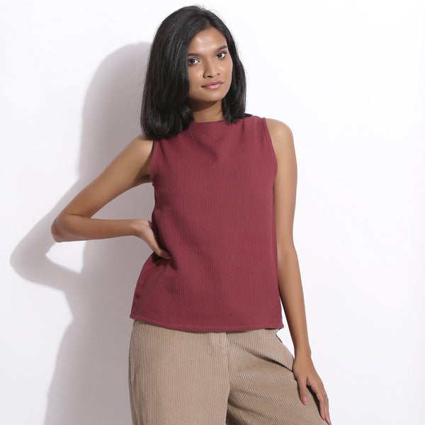Front View of a Model wearing Barn Red Cotton Waffle Funnel Neck Top