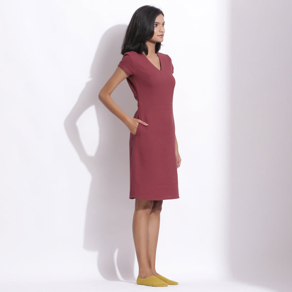 Right View of a Model wearing Barn Red Cotton Waffle V-Neck Dress