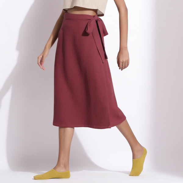 Front View of a Model wearing Barn Red Cotton Waffle Wrap Skirt