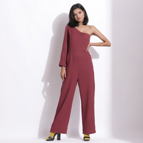 Front View of a Model wearing Barn Red Honeycomb One-Shoulder Jumpsuit