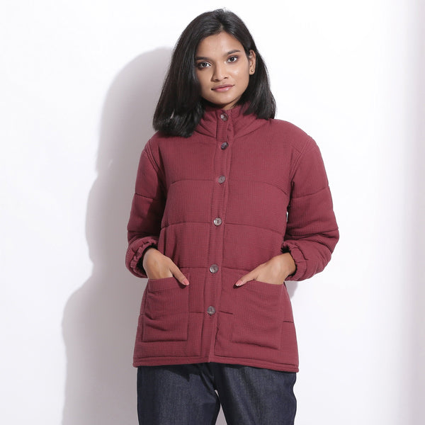 Front View of a Model wearing Barn Red Waffle Quilted Puffer Jacket