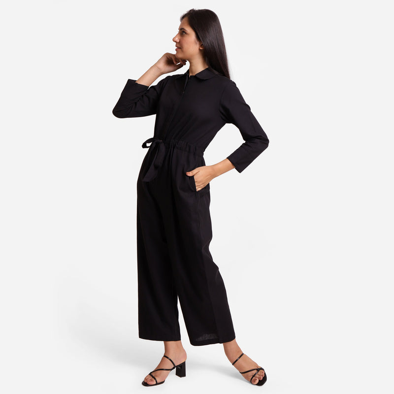 Left View of a Model wearing Black Wide Legged Cotton Overall
