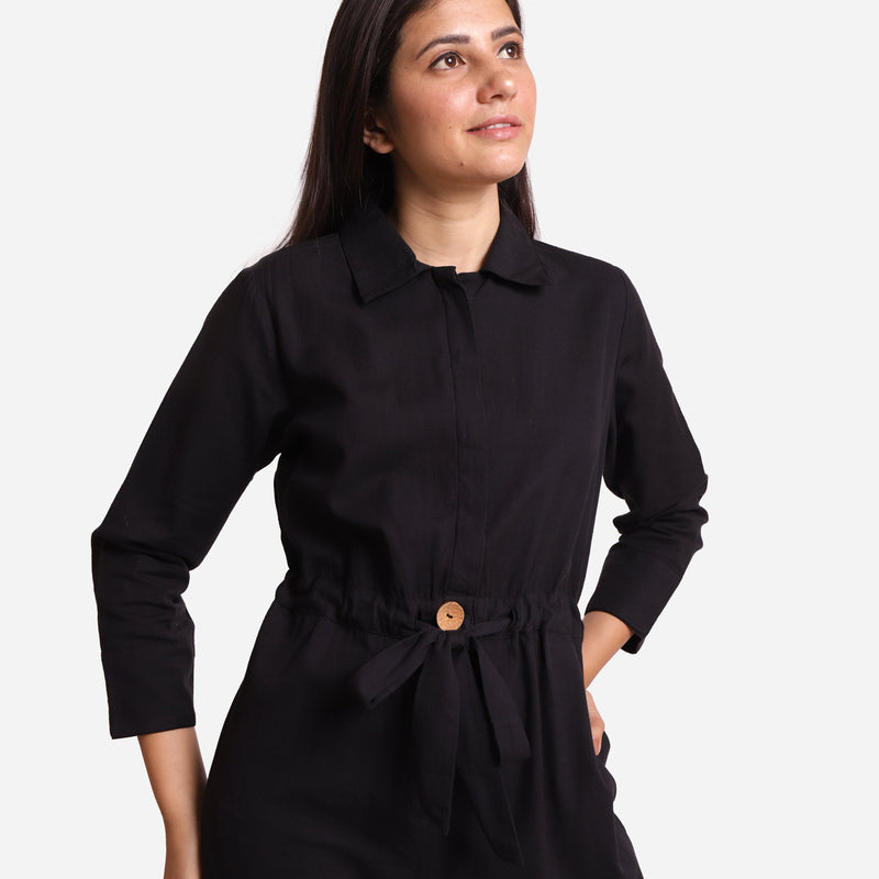 Front Detail of a Model wearing Black Wide Legged Cotton Overall