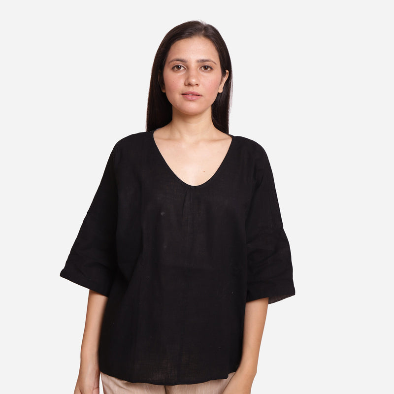 Front View of a Model wearing Black Loose Fit Drop Shoulder Top