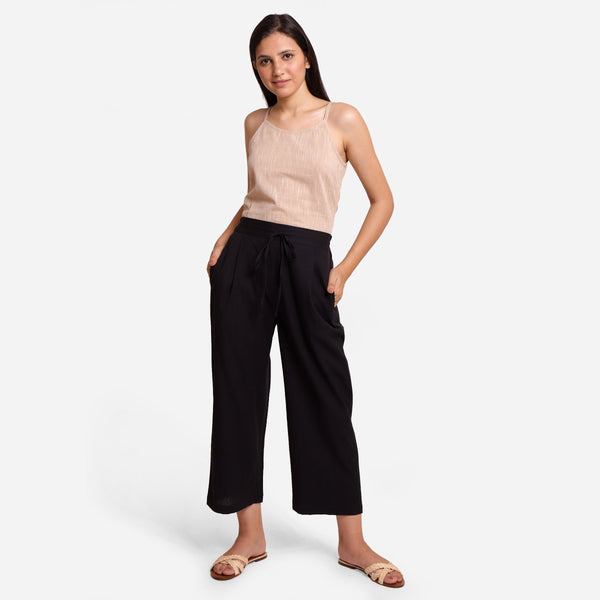 Front View of a Model wearing Black Cotton Flax Wide Legged Pant