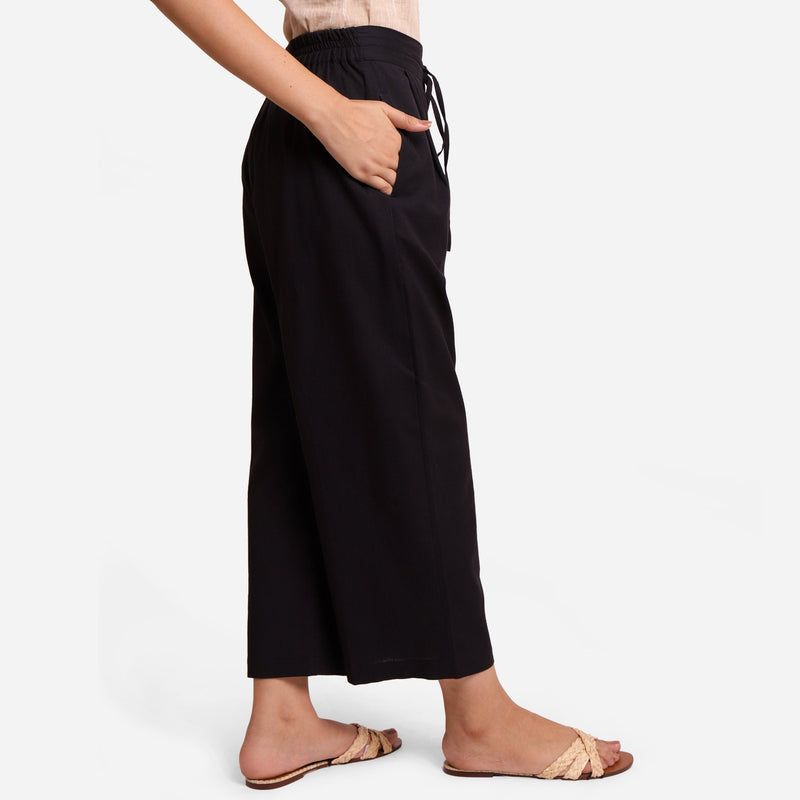 Right View of a Model wearing Black Cotton Flax Wide Legged Pant