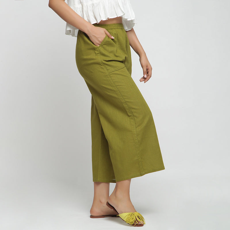 Right View of a Model wearing Olive Green Wide Legged Straight Pant