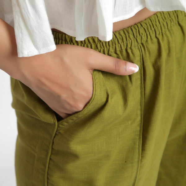 Close View of a Model wearing Olive Green Wide Legged Straight Pant