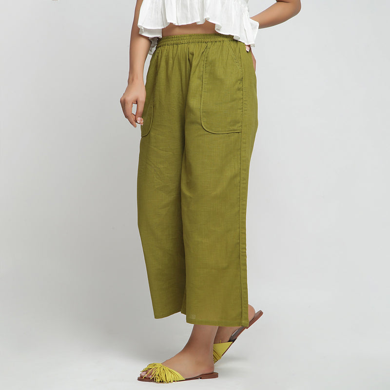 Left View of a Model wearing Olive Green Wide Legged Straight Pant