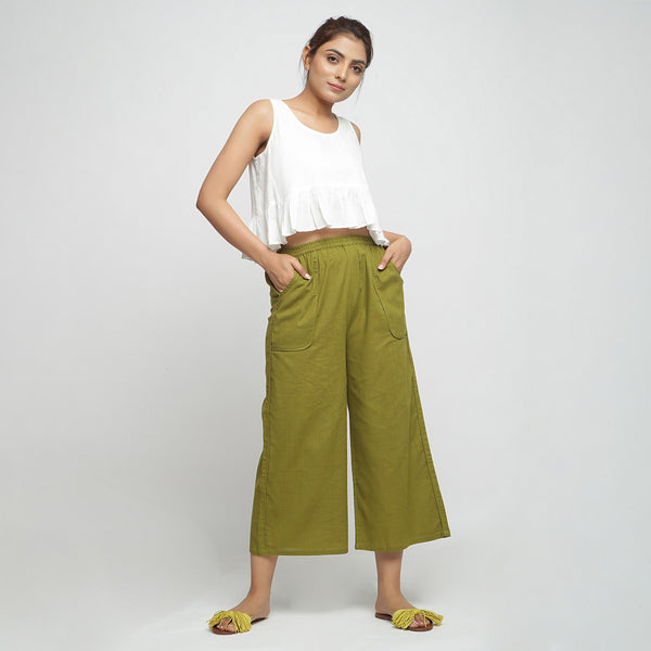 Front View of a Model wearing Olive Green Wide Legged Straight Pant