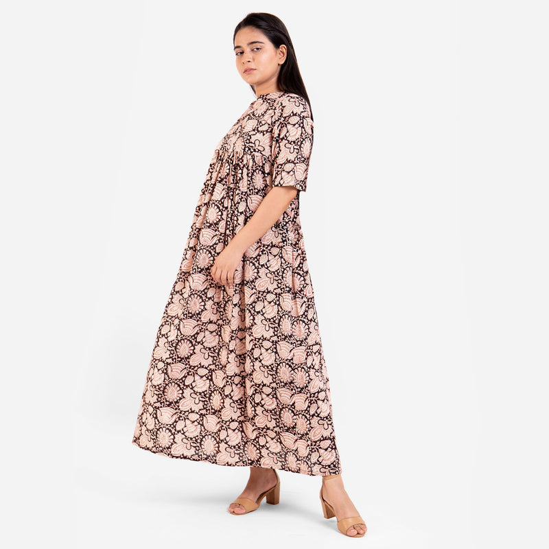 Left View of a Model wearing Beige Bagru Printed Floral Flared Dress
