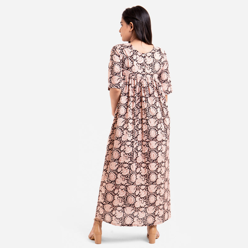 Back View of a Model wearing Beige Bagru Printed Floral Flared Dress