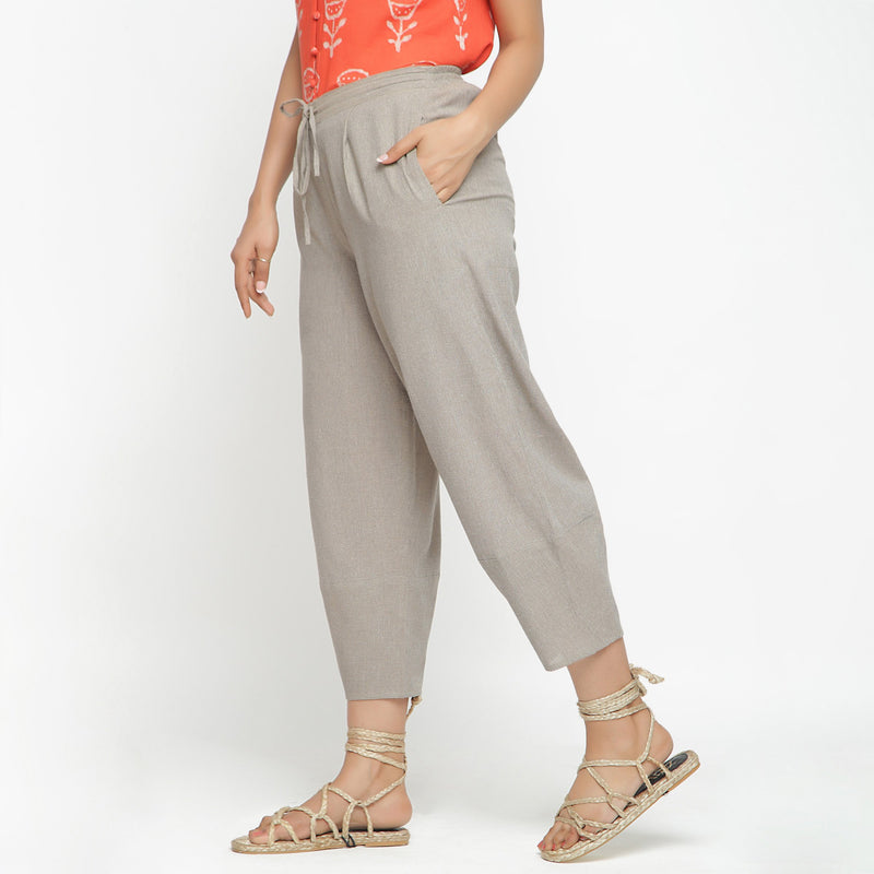 Left View of a Model wearing Yarn Dyed Cotton Beige Paneled Pant