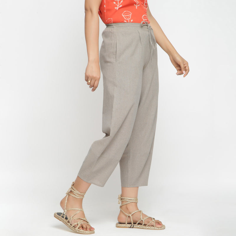 Right View of a Model wearing Yarn Dyed Cotton Beige Paneled Pant
