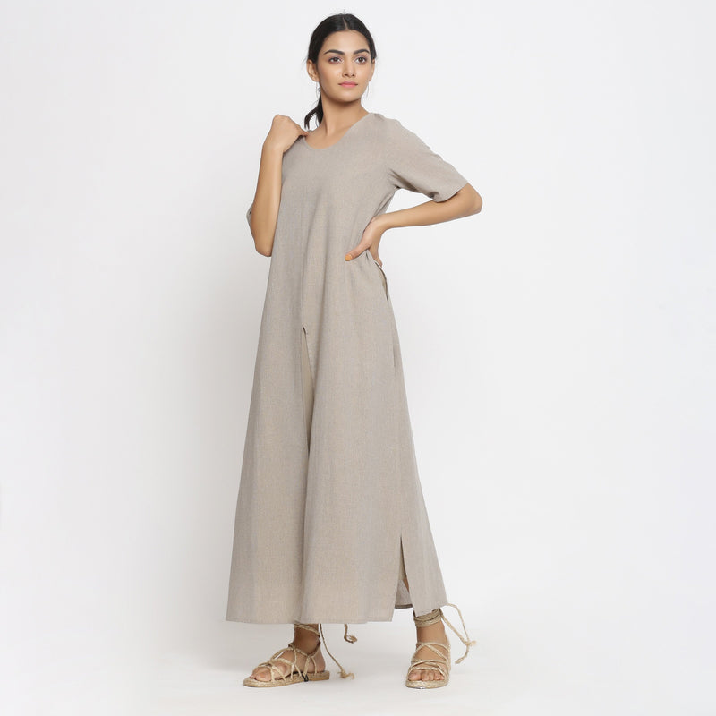 Left View of a Model wearing Beige Cotton Solid A-Line Slit Dress
