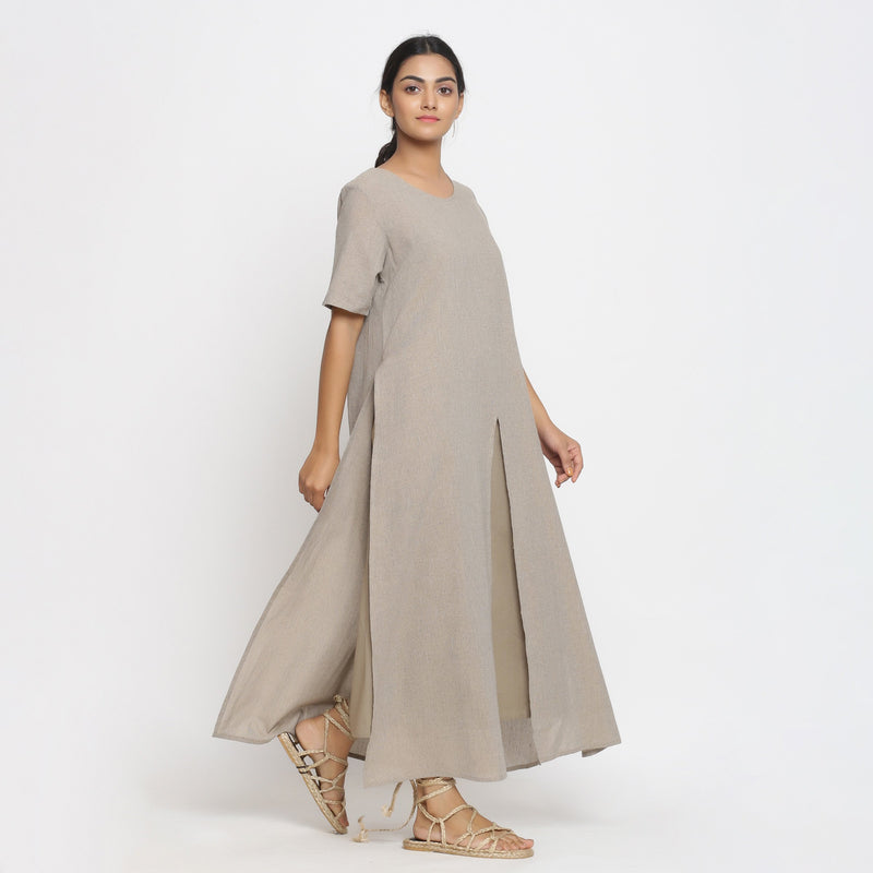 Right View of a Model wearing Beige Cotton Solid A-Line Slit Dress