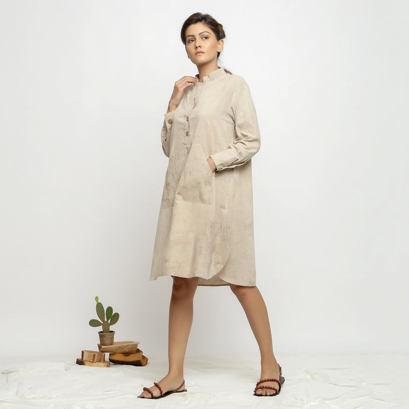 Left View of a Model wearing Beige Dabu Cotton Button-Down Dress