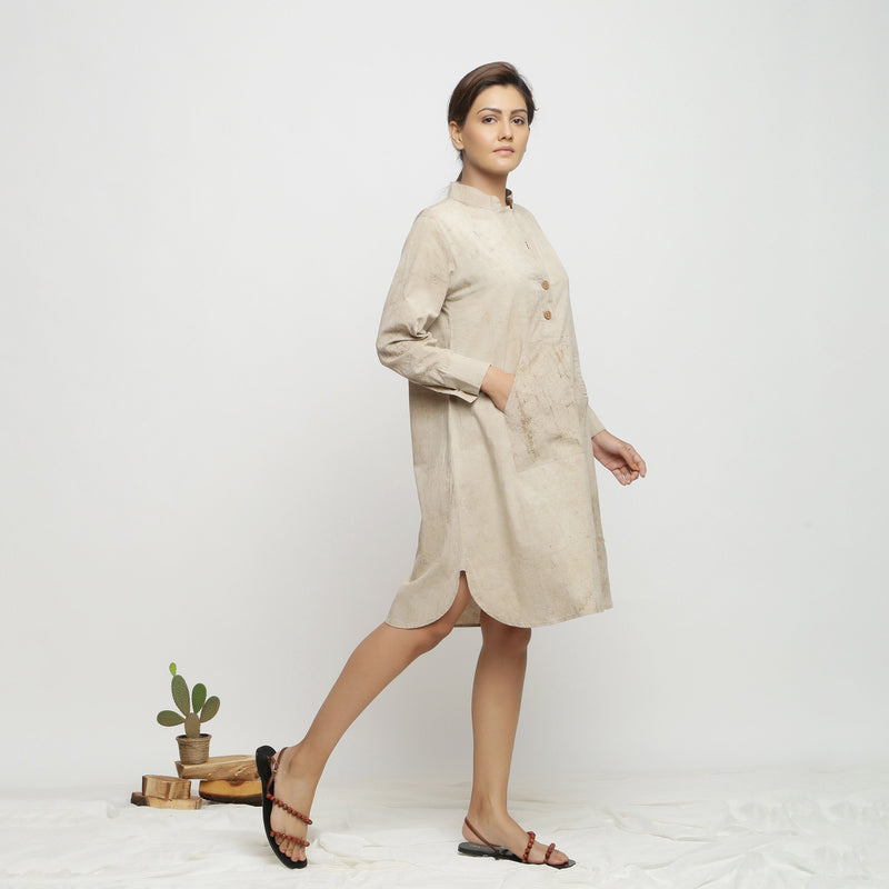 Right View of a Model wearing Beige Dabu Cotton Button-Down Dress