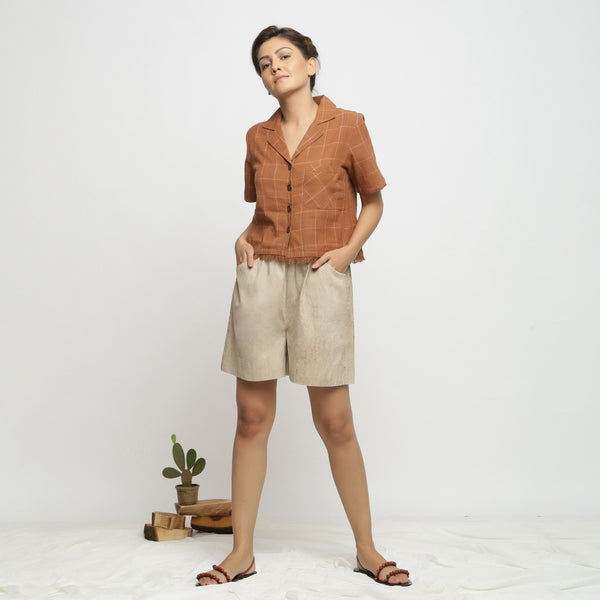 Front View of a Model wearing Beige Dabu Print Cotton Flared Shorts
