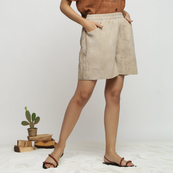 Right View of a Model wearing Beige Dabu Print Cotton Flared Shorts