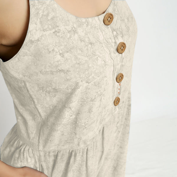 Front Detail of a Model wearing Beige Dabu Printed Button-Down Jumpsuit